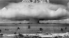"""A test nuclear explosion codenamed """"Baker"""", part of Operation Crossroads, at Bikini Atoll in the Marshall Islands, on July 25, 1946. The 40 kiloton atomic bomb was detonated by the U.S. at a depth of 27 meters below the ocean surface, 3.5 miles from the atoll. The purpose of the tests was to study the effects of nuclear explosions on ships. 73 ships were gathered to the spot -- both obsolete American and captured ships, including the Japanese battleship """"Nagato"""". (NARA)"""