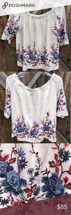 💲68 NWT Drew White Blouse with Floral Embroidery New with tags white peasant blouse with blue and pink floral embroidery. The neckline is smocked and can be worn on or off the shoulders. It is Xsmall but easily fits a size small/medium also because it is a loose flowy top. DREW Tops Blouses
