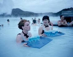 Blue Lagoon, Iceland Drinks blend into the landscape during a summer solstice midnight party in Iceland's Blue Lagoon. Marking the beginning of the season, the summer solstice is the longest day of the year, falling on June 20 or 21.