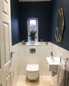 Modern bathroom makeover on the ground floor on a budget - BathroomMake .Modern bathroom makeover on the ground floor on a budget - BathroomMakeover budget Ground floor small with Toilet under stairsToilet under stairsModern bathroom Small Downstairs Toilet, Small Toilet Room, Downstairs Cloakroom, Guest Toilet, Cloakroom Toilet Small, Small Toilet Design, Bathroom Paint Design, Bathroom Interior, Bathroom Ideas