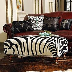ZEBRA OTTOMAN  _  Our zebra leather is stenciled on cowhide by skilled artisans using customized inks and templates in shades of black and white.