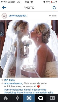 I love pictures of flower girls under the bride's veil--would be so cute