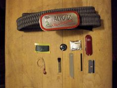 Paracord belt with mini Altoids buckle survival kit