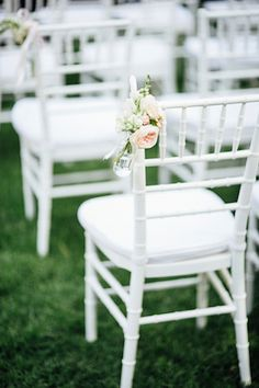 White chairs with peonies   Natasja Kremers Photography   see more on: http://burnettsboards.com/2014/09/glamorous-wedding-cutest-flower-girls/