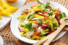 Coconut-poached chicken and mango salad. Our fresh twist on a Vietnamese-style chicken salad is a summertime hit.