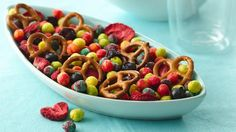 This colorful snack mix is loaded with crunchy cereal and sweet fruit.