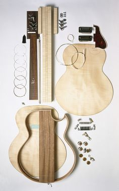 An acoustic guitar. | 16 Things That Are Greater Than Their Parts