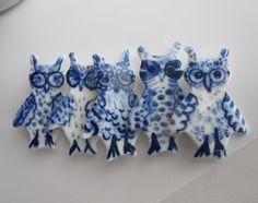 Delft porcelain owls by Harriet Damave on Etsy.