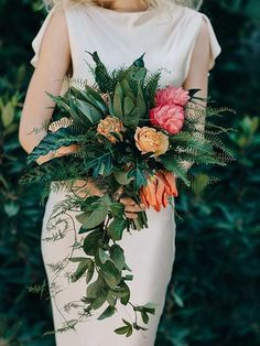 Bold colors, unique textures, unexpected shape -- this offbeat arrangement checks almost every box for the perfect modern wedding bouquet. The dramatic colors and nontraditional floral selections, like parrot tulips, make it an unforgettable addition to the bride's look. Photo: M.K. Sadler/