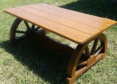 """Beautiful Mid-Century Western Ranch WAGON-WHEEL coffee table. It measures 40 x 22 x 17"""" tall.    I have two additional listings of wagonwheel mahogony furniture (a chair and a set of end tables). I will gladly give a discount for purchasing all...just make me an offer. 