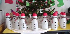 Coffee creamer bottles made into snowmen. Fill with candy. Cute gift idea.  Also, I could have, like, 10 of these by Christmas.  More if I ask friends to save theirs.  would be fun to do snowman bowling too!!