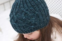 Trying to pick a hat pattern for Michelle.  Sea Beanie pattern by Elena Nodel