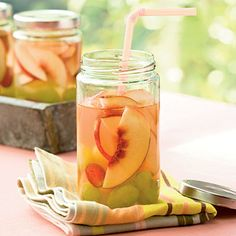 Peach Sangria from Coastal Living:     1 (750-milliliter) bottle white wine  1 cup peach schnapps  1/2 cup frozen lemonade concentrate, thawed  2 nectarines, sliced  1 cup green or red grapes, whole or sliced    Combine all ingredients in a large pitcher. Cover and chill at least 2 hours or overnight. Stir before serving.
