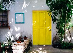 bright yellow door in Tulum, Mexico | photo by Lucy Laucht