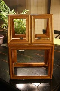 large terrarium made from picture frames, retasked to be display cabinet for horse show ribbons.