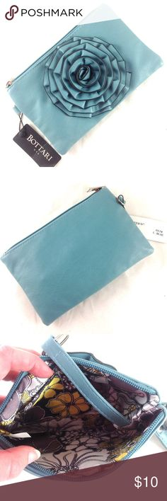 Bottari Flower Wristlet / Clutch Brand new with tags. Light blue. Faux leather. Removable strap. Has keychain attached inside. Interior slip pocket.  8 x 5.  Bundle for the best price and save on shipping!                                            🔹Please ask all your questions before you purchase! I am happy to help! 🔹Sorry, no trades. Bottari Bags Clutches & Wristlets