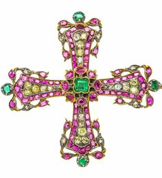 AN ANTIQUE RUBY EMERALD AND DIAMOND BROOCH