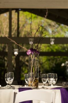 A Gilded Affair, Gilded Petals branch centerpiece with hanging votives. photo by AzulOx Visuals