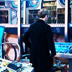 """Gif showing the Twelfth Doctor revealing his new frock coat to Clara in """"Deep Breath."""""""