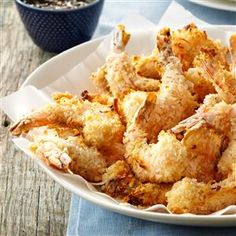 Baked Coconut Shrimp & Apricot Sauce Recipe -Coconut and panko crumbs give this spicy baked shrimp its crunch. It's great for an appetizer or for your main meal. — Debi Mitchell, Flower Mound, Texas
