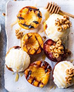 Cinnamon Sugar Grilled Peaches with Vanilla Mascarpone Ice Cream and Honey Nut Cheerios Granola  courtesy of  @halfbakedharvest. Check her out for more delicious cuisines!