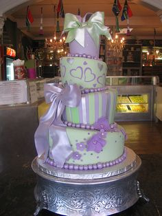 Charly's Bakery CT SA: 4-tier Mad Hatter wedding cake covered in mint & lilac fondant, decorated with lilac flowers, mint & silver stripes, lilac & silver hearts, mint & silver tiny dots & mint & lilac pearlised puffy bowsjpg by Charly's Bakery, via Flickr
