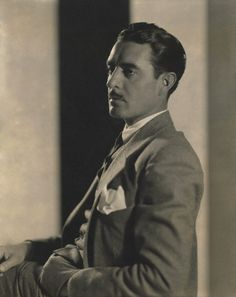 http://chicerman.com  hollywoodcomet:  Born on this day in 1897 was silent film star John Gilbert. He is pictured here in 1927. Original caption: Actor John Gilbert wearing a three-piece suit with a white shirt and tie and a white foulard in his left breast pocket sitting with left hand in his pocket  #MENSUIT #TAILORSUIT