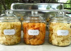 Putting bags of chips out at casual BBQ ~ Great idea using jars with labels!