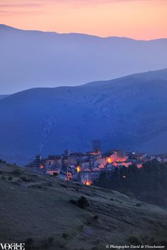 Dusk sets over the 16th-century village of Santo Stefano di Sessanio in Abruzzo, central Italy. The town was resuscitated and authentically restored by Daniele Kihlgren who transformed it into an albergo diffuso - a hotel scattered throughout the town with guests occupying different houses. From Saving Grace, a story on page 168 of Vogue Living Mar/April 2012. Photograph by David de Vleeschauwer.