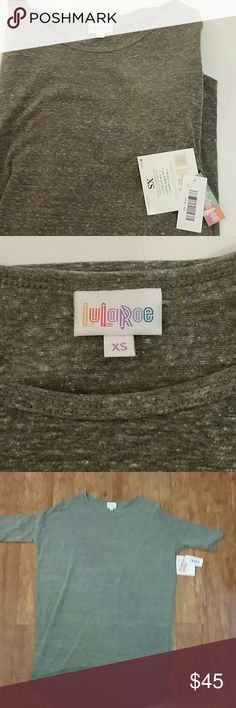 NWT lularoe XS Irma Heathered Grey Lularoe XS Irma Heathered Grey (Consider bundling to get more value out of the cost of Shipping and feel free to make offers on bundles) Thank you for visiting my closet!! SMOKE FREE CLEAN HOME lularoe  Tops Tees - Short Sleeve