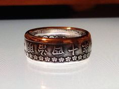 Silver Japanese 50 Sen Coin Ring. The flowers are so pretty and dainty!