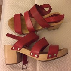 Urban outfitters wooden strap sandal Very comfortable wooden sandals orangey red straps. buckles in the back with a small heel Urban Outfitters Shoes Mules & Clogs