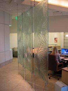 Glass wall partition for entryway
