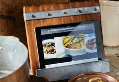 Reclaim to Fame -- The one major problem we have with dining out in this great culinary city is that it's definitely frowned upon to do so without pants. This kitchen conundrum is solved (without resorting to circus acts) with the Reclaimed Wood iPad and Cookbook Holder from Bambeco...
