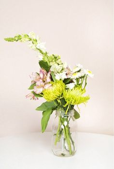 Learn how to arrange flowers like a pro with our easy tutorial at http://dropdeadgorgeousdaily.com/2015/06/arrange-flowers-girls-lvly/