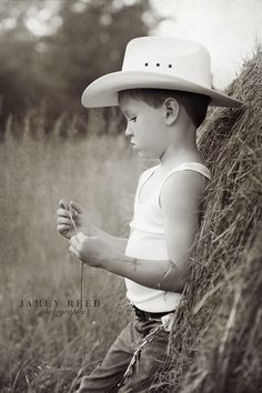 little cowboy ~ cowboy hat ~ tattoo ~ home on the range ~ black and white photography ~ straw ~ deep thought ~ profile ~ jamey reed photography ~ alabama child photographer ~ alabama portrait and commercial photographer ~ child photography ~ first grade ~ little boys ~ wife beater ~ hand cuffs ~ sheriff ~ belt buckle