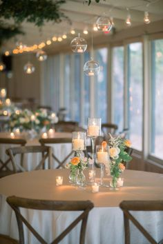 Sweetgrass Social wedding at Middleton Place. Whitney & Trey. Floral centerpiece with raised candles.