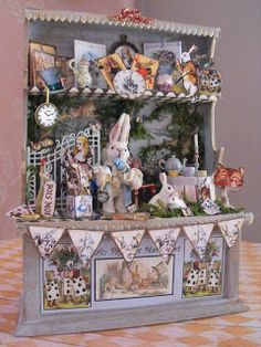 Alice in Wonderland cabinet Miniature Rabbits, Miniature Rooms, Miniature Crafts, Dolls House Shop, Doll Shop, Dollhouse Dolls, Dollhouse Miniatures, Christmas Market Stall, Alice In Wonderland Theme