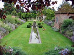 Godinton House & Gardens. The garden was designed by Sir Reginald Blomfield in 1902. It has a Rose Garden, an Italian and Walled Garden, Delphinium borders, a Wild Garden and Ponds.