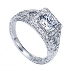 Gabriel and Company Vintage Halo Semi-Mount Engagement Ring made of 14K White Gold style ER7255W44JJ. Marvel piece created by human hand but it seems the creation of higher powers. Engagement ring adorned with multiple round diamonds totaling .25 carat weight.
