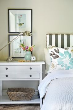 Bold blooms, wide stripes and sweet dreams, this bedroom is a pairing of a designer's favorite things: Color, artwork, texture and pattern. When creating your master suite, remember to consider shape, scale and size of your furniture pieces and don't be afraid of going a bit larger to maximize the form and function of a piece. Use shape, textiles and accents to create a soothing and serene bedroom space.