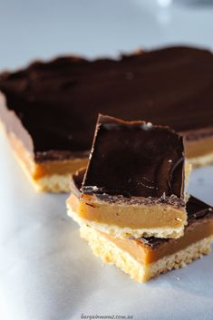 This classic dessert never goes out of style. Caramel slice starts with a biscuit base, is filled with a middle layer of smooth, sticky caramel, and topped with a layer of chocolate. It's the perfect sweet treat! Classic Desserts, Sweet Desserts, Dessert Recipes, Chocolate Topping, Melting Chocolate, Homemade Mocha, Healthy Cream Cheese, How To Make Caramel, Caramel Recipes