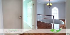 The is the second floor landing to a beautiful century home in Toronto. The light colours with the large window really gives it light, airy and relaxing feel. Home Painters Toronto painted all walls and mouldings. #design #interior #Staircase #lightblue #lightgrey #walls #trims #toronto #chandelier #renovations #window #light #benjaminmoore #paint #bestcolours