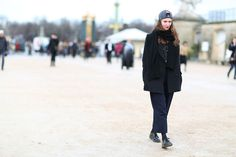 How To Dress Like A French Girl #refinery29  http://www.refinery29.com/63682#slide-35  Cool beanie alternative: a backward cap (paired with a red lip). ...
