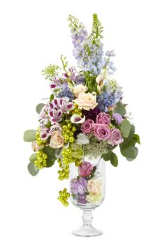 Sit a larger arrangement on top a vase in a LOMEY Dish and decorate the inside with a smaller design for visual interest