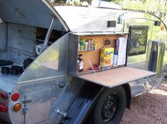 Well a table could be handy, I like how it's by the front door!    A Look Inside A 1938 Tear Drop Trailer