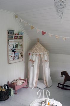 A carnival-inspired canopy similar to this one is on my list of things to make for Little.