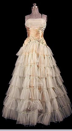 1920s ballgown. | When I was a little girl, my father bought me a white dress that was similar to this, with puffed sleeves. He adored it.