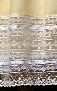 Bands of lace insertion, beading, entredeaux, ribbon at the hem.....just beautiful! Elegant Heirloom by Mattie