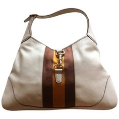 My old ivory Jackie O bag will always be a favorite. (Mine has no stripes - all smooth ivory leather)  borsa-gucci-jackie-o